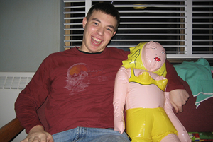 Happy with a blow-up doll